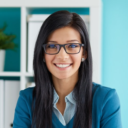 Young business woman wearing black rimmed glasses and smiling