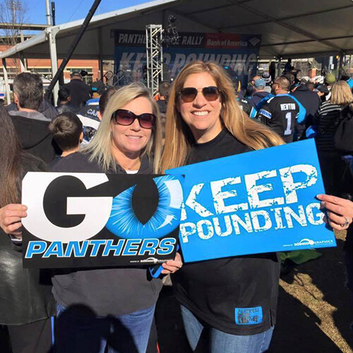 Dr. Carolyn Crowley Correll and friend holding a Go Panthers sign