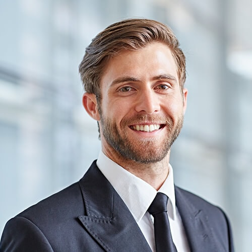 A business man smiling in a suit